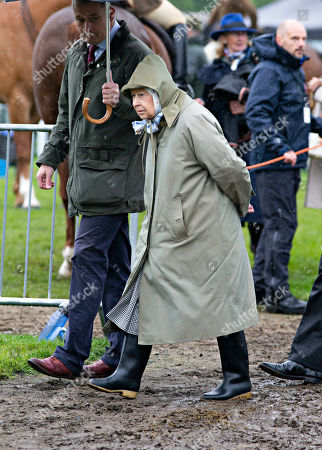 Stock Picture of Queen Elizabeth II leaves after watching her horses in the 4 Year Old Hunter Class