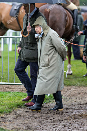 Stock Photo of Queen Elizabeth II leaves after watching her horses in the 4 Year Old Hunter Class