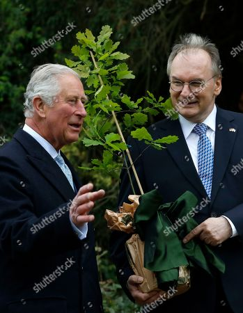 Britain's Prince Charles, the Prince of Wales (L) receives an oak tree as a present from the Premier of Saxony-Anhalt state, Reiner Haselof (R) in Woerlitzer Park, in Woerlitz, Germany, Germany, 08 May 2019. The British royal and his wife are on a three day official visit to Germany.