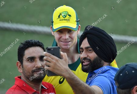 Steve Smith (C) of the Australia XI is seen posing for a selfie photograph with fans after  the One-Day cricket practice match before the World Cup between the Australia XI and New Zealand XI at Allan Border Field in Brisbane, 08 May 2019.