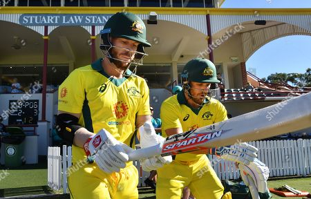 David Warner (L) and Aaron Finch (R) of the Australia XI are seen walking out to bat at the start of the Australia XI innings during the One-Day cricket practice match before the World Cup between the Australia XI and New Zealand XI at Allan Border Field in Brisbane, 08 May 2019.