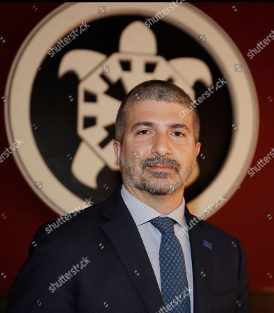 Simone Di Stefano, founder and National secretary of Casapound extreme right political party, poses prior to a news conference, in Milan, Italy