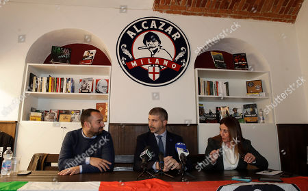 Francesco Polacchi, regional coordinator of Casapound extreme right political party, and founder of Altaforte publishing company, left, is flanked by Simone Di Stefano, founder and National secretary of Casapound and Angela De Rosa, as they answer to reporters during a news conference, in Milan, Italy