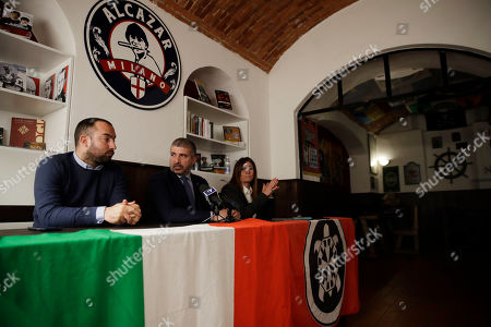 Francesco Polacchi, regional coordinator of Casapound extreme right political party, and founder of Altaforte publishing company, left, is flanked by Simone Di Stefano, founder and National secretary of Casapound and Angela De Rosa, answer to reporters during a news conference, in Milan, Italy