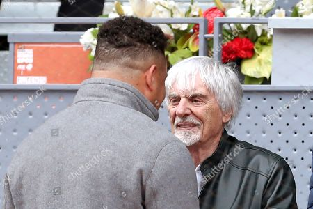 Former Formula One boss Bernie Ecclestone (R) talks with Real Valladolid's president and Brazilian former player, Ronaldo Nazario (L),  at the Mutua Madrid Open tennis tournament, in Madrid, Spain, 08 May 2019.