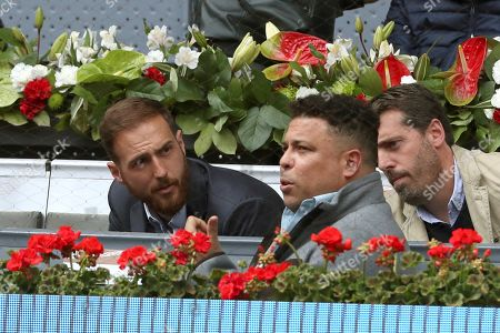 Atletico de Madrid's goalkeeper Jan Oblak (L) and Real Valladolid's president and Brazilian former player, Ronaldo Nazario (C) at the Mutua Madrid Open tennis tournament, in Madrid, Spain, 08 May 2019.