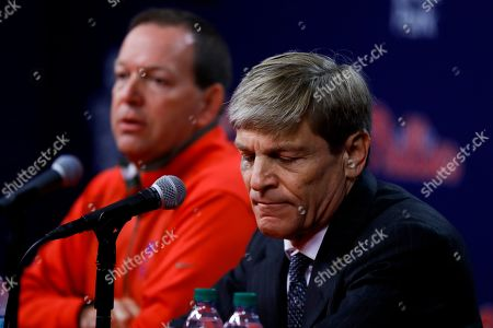 Philadelphia Phillies managing partner John Middleton, right, and executive vice president David Buck listen to a question during a news conference about the passing of team chairman David Montgomery, in Philadelphia. The Phillies say Montgomery, 72, has passed away after a lengthy battle with cancer