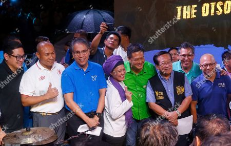 "Samira Gutoc, Mar Roxas, Romulo Macalintal, Florin Hilbay, Gary Alejano, Paolo Benigno ""Bam"" Aquino IV, Jose Manuel ""Chel"" Diokno, Erin Tanada. Opposition senatorial candidates, from left, Benigno ""Bam"" Aquino IV, Gary Alejano, Mar Roxas, Samira Gutoc, Erin Tanada, Romulo Macalintal, Mar Roxas, Gary Alejano, Romulo Macalintal, Jose Manuel ""Chel"" Diokno, and Florin Hilbay, pose for photographers during their last campaign rally together, a few days before the May 13 midterm elections in suburban Quezon city northeast of Manila, Philippines. The midterm elections would elect twelve senators, congressmen and local leaders in the country"
