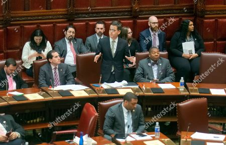 State Sen. Brad Hoylman, D-Manhattan, standing, discusses legislation, at the Capitol in Albany, N.Y., that authorizes state tax officials to release, if requested, individual New York state tax returns to Congress. The bill now goes to the Democrat-led state Assembly after the Democrat-controlled Senate easily passed it
