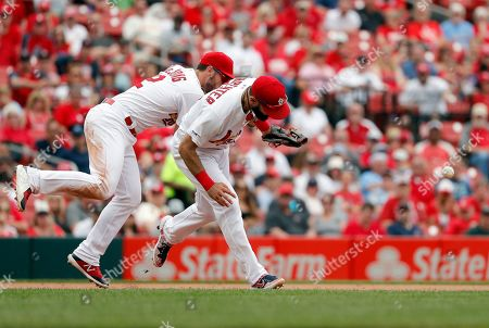 Stock Photo of St. Louis Cardinals third baseman Matt Carpenter, right, and shortstop Paul DeJong collide as they reach for a grounder by Philadelphia Phillies' Maikel Franco during the fifth inning of a baseball game, in St. Louis. Franco reached first on a fielder's choice while Odubel Herrera scored and Carpenter was charged with an error on the play