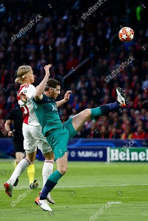 Ajax's Kasper Dolberg, left, vies for the ball with Tottenham's Jan Vertonghen during the Champions League semifinal second leg soccer match between Ajax and Tottenham Hotspur at the Johan Cruyff ArenA in Amsterdam, Netherlands