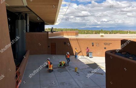 "Construction workers make final preparations for the summer season at the Santa Fe Opera, in Santa Fe, N.M. Opera General Director Robert Meya announced they will stage the world premiere in 2020 of the gender-bending story ""M. Butterfly"" from playwright and librettist David Henry Hwang"