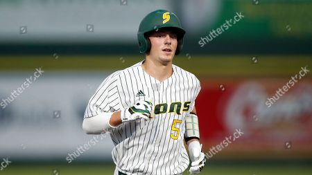 Stock Image of Southeastern Louisiana catcher Connor Manola (5) runs to third base during an NCAA college baseball game against McNeese, in Hammond, La