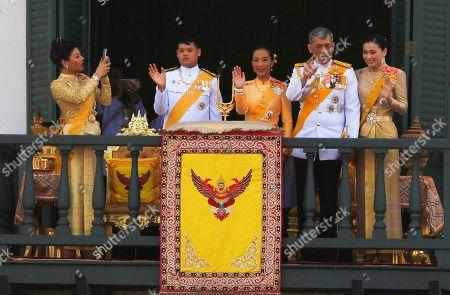 Stock Photo of Members of the Thai royal family Princess Sirivannavari Nariratana, Prince Dipangkorn Rasmijoti, Princess Bajrakitiyabha, King Maha Vajiralongkorn Bodindradebayavarangkun and Queen Suthida appear on the balcony of Suddhaisavarya Prasad Hall of the Grand Palace during a public audience on the last day of his royal coronation in Bangkok.