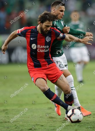 Stock Picture of Fabricio Coloccini of Argentina's San Lorenzo, left, fights for the ball with Rafael Veiga of Brazil's Palmeiras during a Copa Libertadores soccer match in Sao Paulo, Brazil