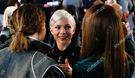 US actress Michelle Williams (C) talks to French actress Lea Seydoux (L) and US actress Emma Stone (R) before the start of French designer Nicolas Ghesquiere fashion show for the Louis Vuitton label during the Louis Vuitton Cruise 2020 Show at the TWA Flight Center of John F. Kennedy International Airport in New York, New York, USA, 08 May 2019.
