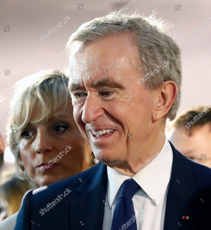 Chief Executive of LVMH Bernard Arnault (R) and wife Helene Mercier-Arnault (L) stand in the audience before the start of French designer Nicolas Ghesquiere fashion show for the Louis Vuitton label during the Louis Vuitton Cruise 2020 Show at the TWA Flight Center of John F. Kennedy International Airport in New York, New York, USA, 08 May 2019.