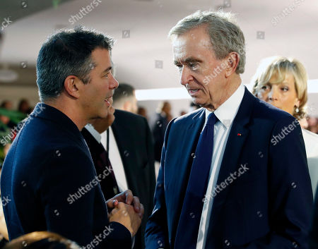 US billionaire and Co-founder of Scour, Red Swoosh and Uber Travis Kalanick (L) chats with Chief Executive of LVMH Bernard Arnault (R) and Helene Mercier-Arnault (C) is seen in the audience before the start of French designer Nicolas Ghesquiere fashion show for the Louis Vuitton label during the Louis Vuitton Cruise 2020 Show at the TWA Flight Center of John F. Kennedy International Airport in New York, New York, USA, 08 May 2019.