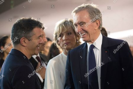 Bernard Arnault, Helene Mercier Arnault, Travis Kalanick. Bernard Arnault, right, Chairman and CEO of LVMH Moët Hennessy, and his wife Helene Mercier Arnault, center, speak to Travis Kalanick, the former C.E.O. of Uber, before the start of the Louis Vuitton Cruise 2020 collection presentation, in New York