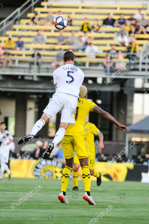 Los Angeles Galaxy defender Daniel Steres (5) jumps over Columbus Crew SC forward Gyasi Zerdes (11) in the first half of the match between Los Angeles Galaxy and Columbus Crew SC at MAPFRE Stadium, in Columbus OH. Mandatory Photo Credit: Dorn Byg/Cal Sport Media. ..Los Angeles Galaxy 0 - Columbus Crew SC 1