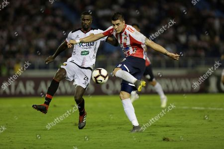 Junior's Michael Rangel (R) vies for the ball with Melgar's Christian Ramos (L) during the Copa Libertadores group F soccer match between Atletico Junior and Melgar at Metropolitano stadium in Barranquilla, Colombia, 08 May 2019.
