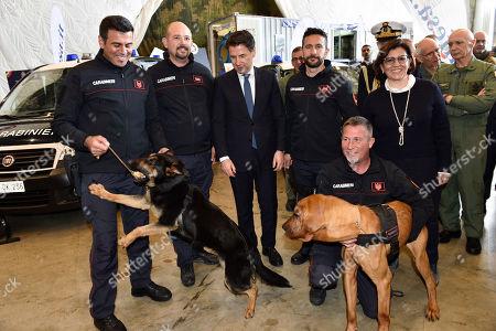 Giuseppe Conte and Elisabetta Trenta with the Zagor dog