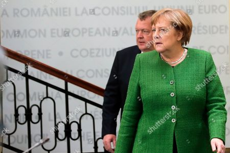 German Federal Chancellor Angela Merkel (front) and Denmark's Prime Minister Lars Lokke Rasmussen (rear) during an Informal Summit of Heads of State or Government of the EU countries in Sibiu, Romania, 09 May 2019. EU leaders are expected to discuss the union's strategic agenda for the 2019-2024 period as well as exchanging views on EU challenges and priorities for the years to come.