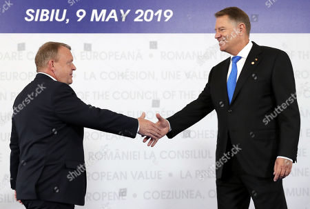 Denmark's Prime Minister Lars Lokke Rasmussen (L) is welcomed by Romanian President Klaus Iohannis (R) at the beginning of the Informal Summit of Heads of State or Government of the European Union, held at the City Hall of Sibiu city, 275 Km north from Bucharest, Romania, 09 May 2019.
