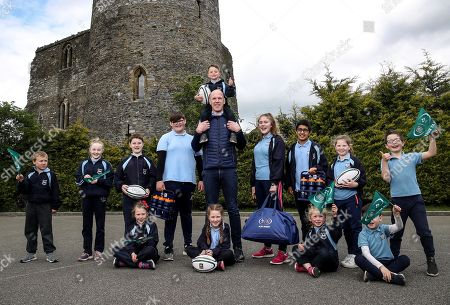 Aldi and the IRFU today announced the two winners of the hugely successful sticker competition for primary schools, which ran from January until April this year, with each school winning ?50,000 for their playing facilities! Pictured are pupils from Scoil Naomh Maodhóg from Ferns, Co. Wexford, alongside former Ireland and Munster Rugby Captain and Aldi Play Rugby Ambassador Paul O'Connell. The other winning school was Scoil Naomh Treasa from Tiernasligo, Co. Donegal.
