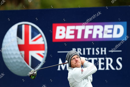 Stock Photo of David Horsey of England tees off on the 15th during Day One of the Betfred British Masters at Hillside Golf Club