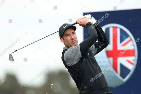 Ross Fisher of England tees off on the 4th during Day One of the Betfred British Masters at Hillside Golf Club