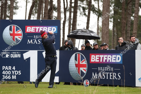 Stephen Gallacher of Scotland tees off on the 12th during Day One of the Betfred British Masters at Hillside Golf Club
