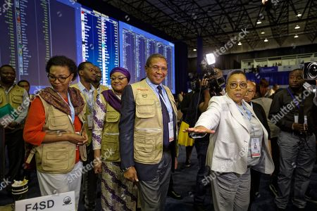 Stock Image of Former President of Tanzania Jakaya Kikwete, center, who is leading the African Union Election Observation Mission, is shown the Independent Electoral Commission (IEC) Results Center in Pretoria, South Africa . South Africans voted Wednesday in a national election that pits President Cyril Ramaphosa's ruling African National Congress against top opposition parties Democratic Alliance and Economic Freedom Fighters, 25 years after the end of apartheid