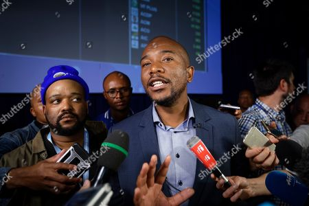 Mmusi Maimane, leader of the largest opposition party, the Democratic Alliance, speaks to the media as he visits the Independent Electoral Commission Results Center in Pretoria, South Africa . South Africans voted Wednesday in a national election and preliminary results show that the ruling African National Congress party (ANC) has an early lead in the national elections but has seen its share of the vote drop significantly