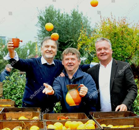 Raymond Blanc (left) joins designers Jean-Yves Baril and Jason Hales(right) jugling Oranges in the 'Villaggio Verde' 'Orange Express' garden