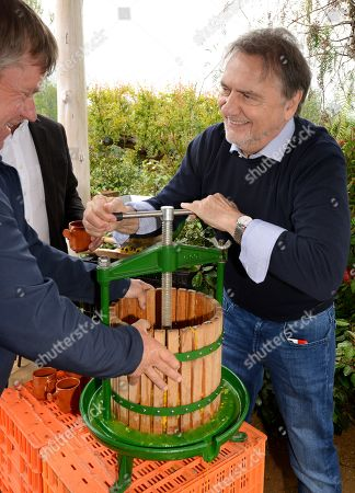 Raymond Blanc (right) joins designer Jean-Yves Baril (left) squeezing Oranges in the 'Villaggio Verde' 'Orange Express' garden