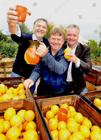 Stock Photo of Raymond Blanc (left) joins designers Jean-Yves Baril and Jason Hales(right) amongst the Oranges in the 'Villaggio Verde' 'Orange Express' garden