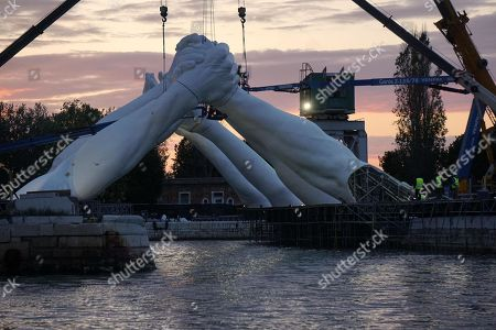 The installation 'Bridges' by Us artist Lorenzo Quinn at the 58th International Art Exhibition of the Biennale in Venice, Italy, 09 May 2019. The art event runs from 11 May to 24 November 2019.