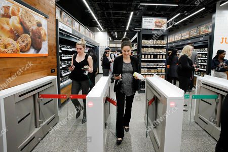 Cashier Stock Photos, Editorial Images and Stock Pictures | Shutterstock