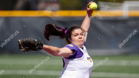 Stock Picture of Northern Iowa's Jaclyn Spencer delivers against Loyola during an NCAA softball game on in Chicago