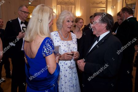 Britain's Camilla, Duchess of Cornwall (C) chats with the Bavarian prime minister's wife Karin Soeder (L) and German actor Elmar Wepper (R) during a State Banquet in honor of the British royal couple in the Kaisersaal (emperor's hall) at the Munich Residence, in Munich, Germany, 09 May 2019. The British royals are on a three day official visit to Germany.