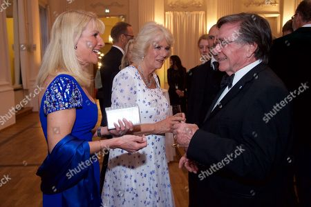Stock Photo of Britain's Camilla, Duchess of Cornwall (C) chats with the Bavarian prime minister's wife Karin Soeder (L) and German actor Elmar Wepper (R) during a State Banquet in honor of the British royal couple in the Kaisersaal (emperor's hall) at the Munich Residence, in Munich, Germany, 09 May 2019. The British royals are on a three day official visit to Germany.