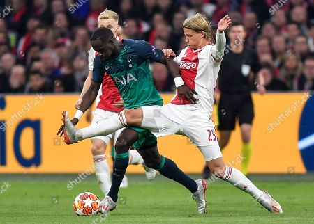 Tottenham midfielder Moussa Sissoko, left, and Ajax's Kasper Dolberg challenge during the Champions League semifinal second leg soccer match between Ajax and Tottenham Hotspur at the Johan Cruyff ArenA in Amsterdam, Netherlands