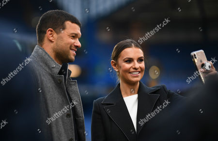 Former Chelsea and Germany player Michael Ballack poses for a photo with a German TV presenter