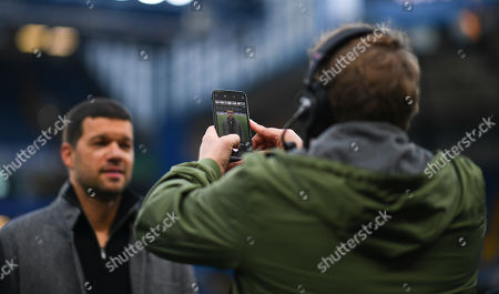 Stock Image of Former Chelsea and Germany player Michael Ballack poses for a photo with a German TV presenter