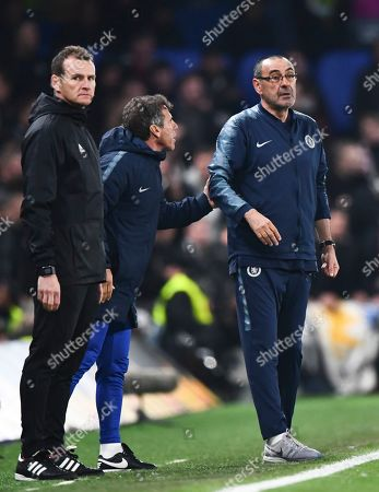 Chelsea Manager Maurizio Sarri is pulled back from the edge of the pitch by assistant Gianfranco Zola