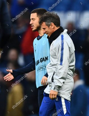 Eden Hazard of Chelsea alongside assistant manager Gianfranco Zola