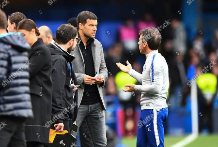 Chelsea assistant Gianfranco Zola chats with Michael Ballack