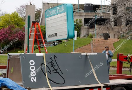 "Steve Sanford, of Johnson Sign Co., helps remove the Chene Park sign before replacing it with the new Aretha Franklin signage, in Detroit. Mayor Mike Duggan told mourners at the Queen of Soul's funeral in August that the name would be changed, saying that ""when Franklin sang, it sounded like the voice of Detroit."" Days later, City Council unanimously approved it. The facility is known for its outdoor stage and summer concerts. Franklin died Aug. 16 at 76"