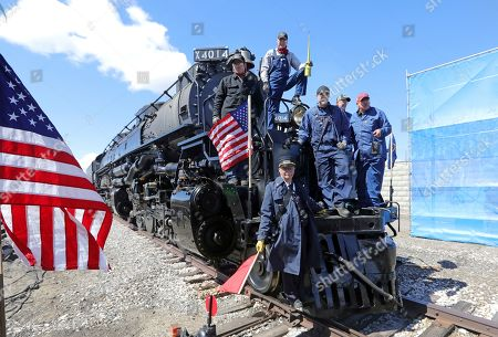 The crew from the Big Boy, No. 4014 pose for a photograph during the commemoration of the 150th anniversary of the Transcontinental Railroad completion at Union Station, in Ogden, Utah